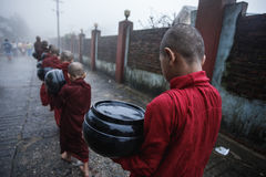 Buddhism in Myanmar. Novice  alms  and Buddhism in Myanmar Stock Photography