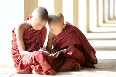 Buddhism novices are reading and study royalty free stock images