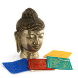 Buddhism objects. Buddhism religion with buddha and colored flags Royalty Free Stock Image