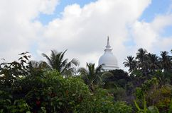 Buddhism pagoda in the top of the jungle Stock Photo