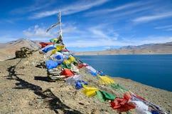 Buddhism prayer flags in Himalayas. Tibetan prayer flags at lake Tso Moriri in Himalayas, Ladakh, India,  altitude 4600 m Stock Photography