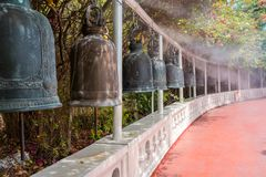 The Buddhism religious bell in the temple Golden Mountain or Wat Saket. The Buddhism religious bell. Closeup shot of iron bells hanging in the temple Golden royalty free stock photo