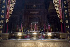 Incense sticks burning in Buddhist temple. In Buddhism, it is a sacred offering, a way to honor the Triple Gem of the Buddha, his Dharma and the Sangha. The Stock Photos
