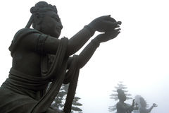 Buddhism Statue. A buddhism statue in gesture of offering Stock Photos