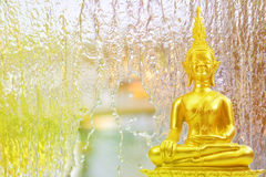 Buddhism statue on Water fall in garden,abstract background Stock Photos