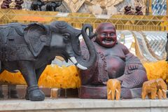Buddhism Strength. Statue of Buddha with elephants at a shrine stock photography