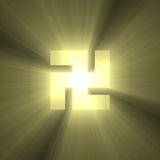 Buddhism swastika sign of buddha light flare. Symbol of Buddha or Buddhism illustrated with powerful golden sun light halo, and symbolic meanings of All and Royalty Free Stock Photo