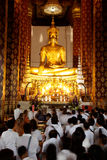 Buddhism Thai peoples worship on main Buddha in temple. Royalty Free Stock Photography
