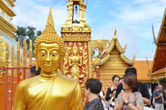 Buddhism and tourist ceremony walk around pagoda contain Buddha ash in ancient temple. Chiang Mai Thailand December 3, 2016 : Buddhism and tourist ceremony walk Royalty Free Stock Photos