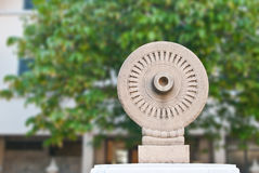 Buddhism wheel with stone Royalty Free Stock Image
