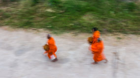 Buddhist alms blur. View from above, priests were walking alms rushed measurement sensitivity to motion blur stock images