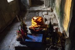 Buddhist altar with ancient stone Buddha statue. Ancient Buddha statue in Ta Prohm temple stock images
