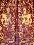 Buddhist art. Paintings on the doors of a buddhist temple in Chiang Mai, Thailand royalty free stock images