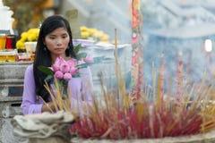 Buddhist Asian woman praying Stock Image