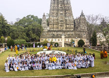 Buddhist believers in front of Mahabodhi temple Stock Photo