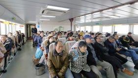 Buddhist believer and tourist take ferry to putuoshan island, adobe rgb. Buddhist believers and tourists take ferry to putuoshan island to pray. putuoshan island Stock Photos