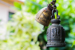 Buddhist bell. A bell with a national ornament on the nature background Stock Images