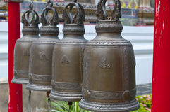 Buddhist bells. Bronze bells at a Buddhist temple in Thailand Stock Photo