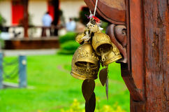 Buddhist bells. And green meadow Stock Photography
