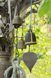 Buddhist bells hanging on a tree branch mascots in Thailand Royalty Free Stock Photo