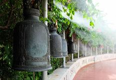 Buddhist bells made of iron / bronze hanging in a curved row Stock Photography