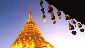 Buddhist brass bell at the roof of thai temple with soft blurred golden stupa, Wat Phra That Doi Suthep, Chiang mai, Thailand stock photos