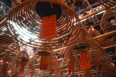 Buddhist brown spiral burning sticks in the Man Mo Temple royalty free stock photos