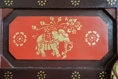 A buddhist carving typical of the sort that adorns the outside of homes or shops in Thailand. Stock Images