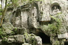 Buddhist carvings in Feilai Feng Caves Royalty Free Stock Photo