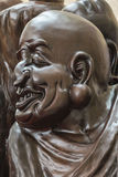 Buddhist carvings Lohan Photos Stock Photo