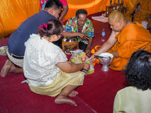 Buddhist ceremony philanthropy offer food alms to monk. Buddhist ceremony philanthropy offer food alms to monk at Nhong Nam Keaw village, Banbung, Chonburi royalty free stock photography