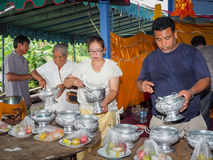 Buddhist ceremony philanthropy offer food alms to monk. Buddhist ceremony philanthropy offer food alms to monk at Nhong Nam Keaw village, Banbung, Chonburi royalty free stock images