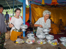 Buddhist ceremony philanthropy offer food alms to monk. Buddhist ceremony philanthropy offer food alms to monk at Nhong Nam Keaw village, Banbung, Chonburi stock photography