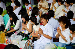 Buddhist charity and merits. Royalty Free Stock Photo
