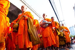 Buddhist charity and merits. Royalty Free Stock Image