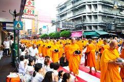 Buddhist charity and merits. The occasion BuddhaJa Royalty Free Stock Photo