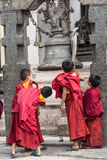 Buddhist Children at a Shrine Royalty Free Stock Image