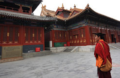 Buddhist in Chinese Lama Temple. A buddhist monk in the Yonghe Temple , also known as the Lama Temple. Formerly an imperial palace, it became a Tibetan Buddhist stock photography