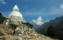 Buddhist chorten and Ama-Dablam royalty free stock photography