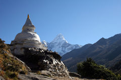 Buddhist Chorten - Nepal. Buddhist Chorten along the trail from Tengboche to Pheriche just before Pangboche. Ama Dablam is in the background Stock Image