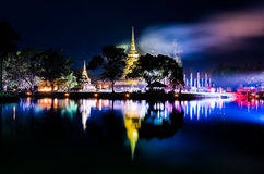 Buddhist colorful temple at night with lake reflection Stock Photo