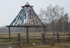 Buddhist construction with Zalaal - tied tapes. Territory of temple-monastery in Arshan village. Tunkinsky district of Buryatia Royalty Free Stock Images