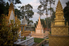 Buddhist Countryside Wat and Pagoda at Dusk. In Cambodia, Southeast Asia. The markers of former monks and elders can be seen spanning the grounds Stock Images