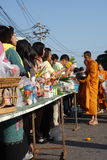 Buddhist culture: Providing food to monks during special event. Buddhist culture: Many people are providing food to monks during special event in Thailand Royalty Free Stock Photos