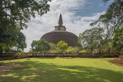Buddhist dagoba stupa Polonnaruwa, Sri Lanka. Rankoth Vehera, the largest Buddhist dagoba at the ruins of the ancient kingdom capital Polonnaruwa, Sri Lanka royalty free stock photography