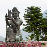 Buddhist Deva statue. Buddhist statue at Po Lin Monastery, Hong Kong Royalty Free Stock Image