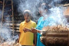 Buddhist devotee burn incense sticks Royalty Free Stock Photo
