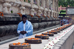 Buddhist devotee next to the Mahabodhi temple Royalty Free Stock Image