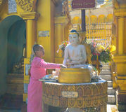 Buddhist devotees bathing Buddha statues at Shwedagon Pagoda Stock Photo