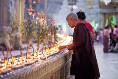 Buddhist devotees lighting candles at the full moo Royalty Free Stock Photo